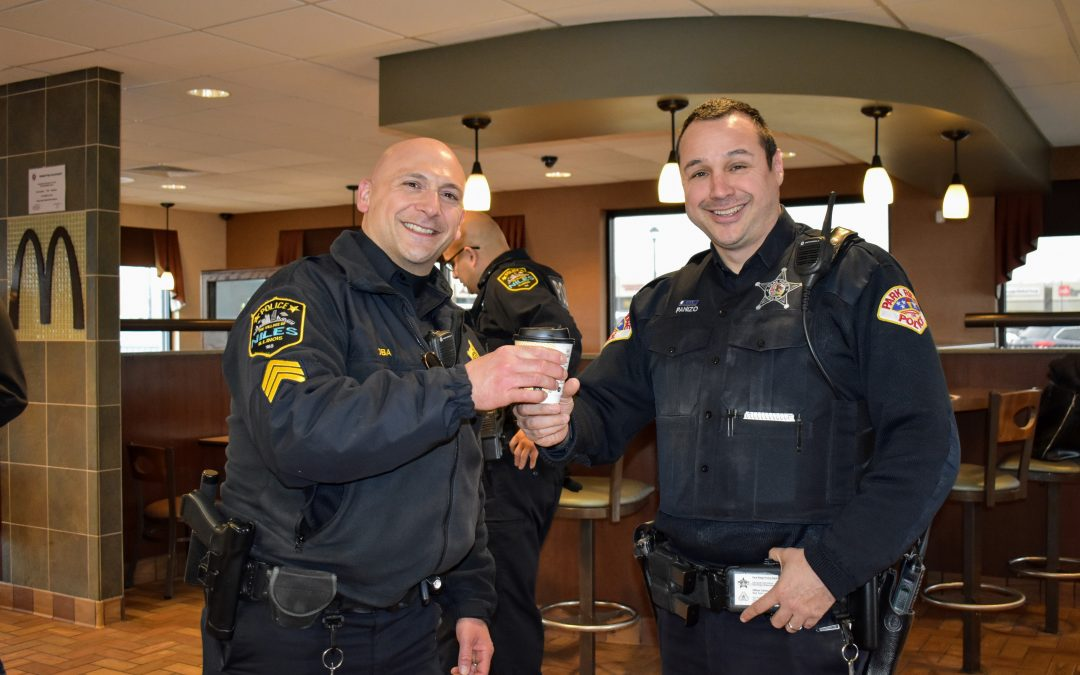 Niles Officers serve Hot Chocolate at Local McDonald's