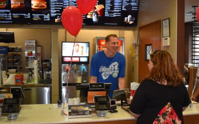 Coaches and Team Members Work Hard at McDonald's during McCoaches Night.